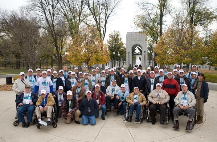 Jeremy Hogan | Herald-Times  Bloomington area World War II Veterans and their guardians pose for a group photo at the entrance to the WWII memorial in Washington, D.C.